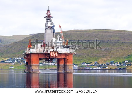 Oil rig stands in the Bay Faroe Islands. In anticipation of the sea. - stock photo