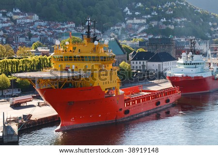 Oil Rig Supply Boat at Bergen Harbor, Norway. City of Bergen in the background.