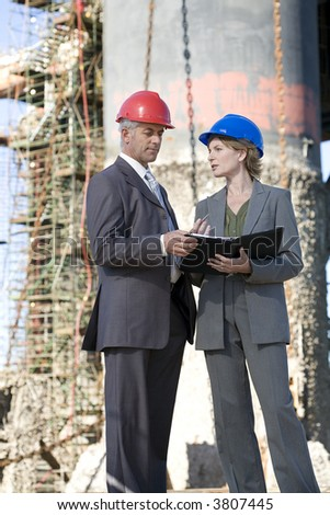 Oil rig survey engineers - stock photo