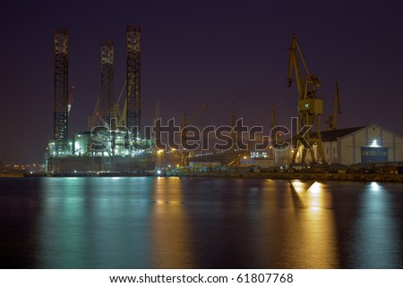 Oil rig under repair at the shipyard. - stock photo