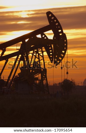 Oil rigs silhouette over orange sky-5