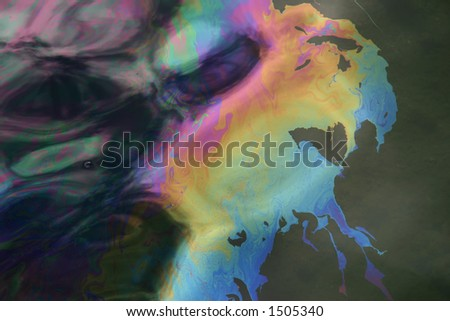 Oil slick from USS Arizona in Pearl Harbor.  Oil still seeps from the ship sunk on Dec. 7, 1941. - stock photo