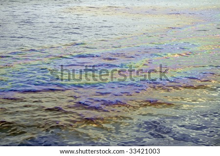 Oil slick iridescent rainbow - stock photo