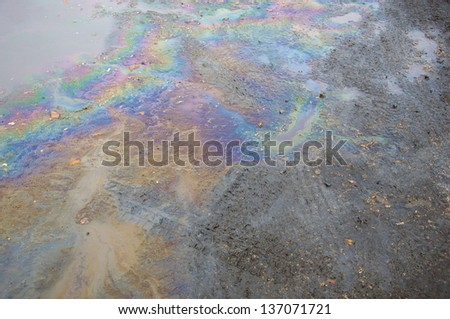 Oil slick on the road. - stock photo