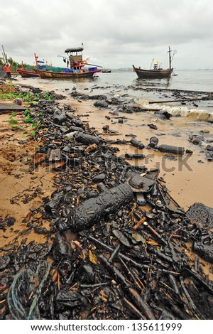 Oil spill. Contaminated Beach in Chonburi, Thailand. - stock photo