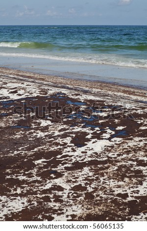 Oil spill on Gulf Coast beach from a leaking offshore well. - stock photo