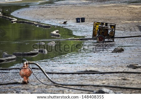 Oil stained at Ao Prao Beach, Koh Samet, Rayong, Thailand  - stock photo