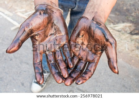 Oil stained hands dirty - stock photo
