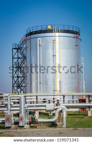 Oil storage and pipeline - stock photo