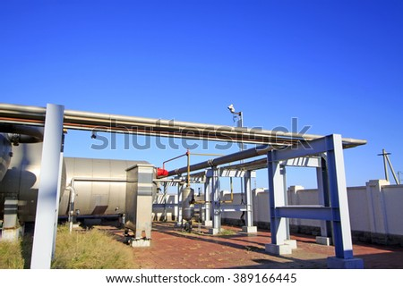 Oil storage and transportation facilities in an oilfield, closeup of photo