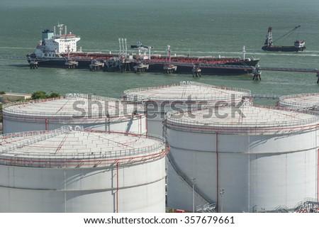 Oil Storage tank and oil tanker - stock photo
