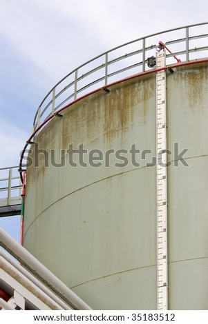 Oil storage tank with level meter - stock photo