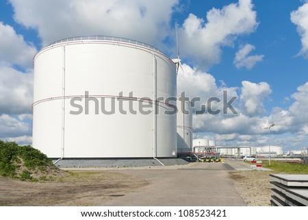 oil storage tanks in amsterdam harbor - stock photo
