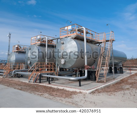 Oil tank and reservoir on gas refinery plant . Gas transit station - stock photo