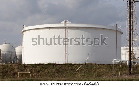Oil tank at refinery - stock photo