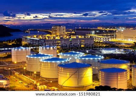 Oil tank at sunset in Hong Kong - stock photo