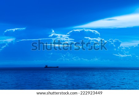 Oil tank ship sailing in cloudy day - stock photo