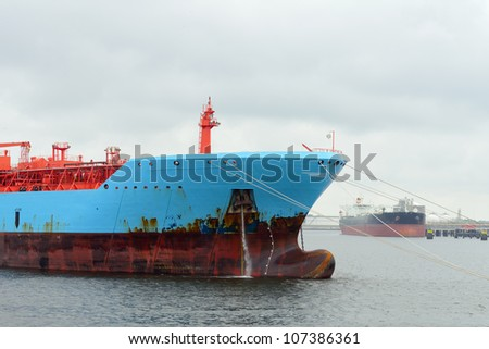 oil tanker and gas ship in the harbor of rotterdam - stock photo
