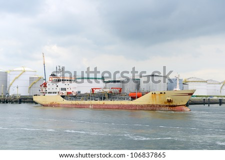 oil tanker and oil terminal in the harbor of rotterdam - stock photo