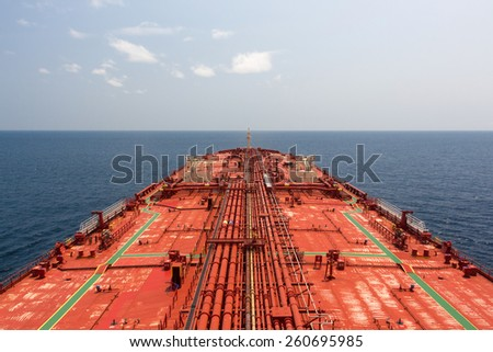 Oil tanker deck under blue sunny sky. View from monkey deck. - stock photo - stock photo