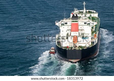 Oil tanker departs harbor - stock photo