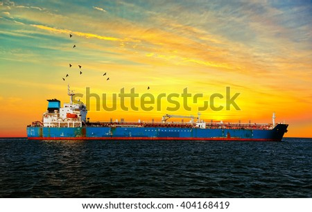 Oil Tanker in the sea at sunset. - stock photo