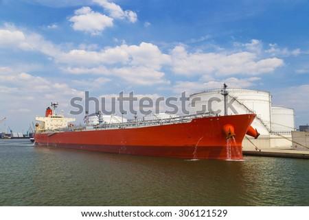 Oil tanker moored near an oil silo in Port of Antwerp, Belgium - stock photo