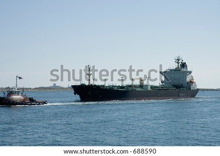 Oil tanker on St Charles River and tow boat, Boston Mass - stock photo