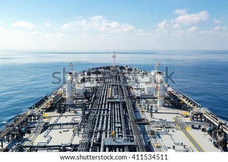 Oil tanker proceeding through the sea - stock photo