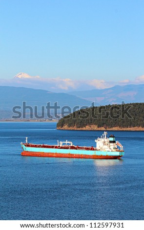 Oil tanker ship in Padilla Bay, Anacortes, Washington State with Mt Baker in the background. - stock photo