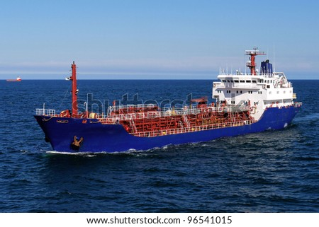 Oil Tanker, Underway at sea over blue sky and sea. - stock photo