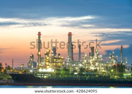 Oil tankers in front of the refinery. - stock photo