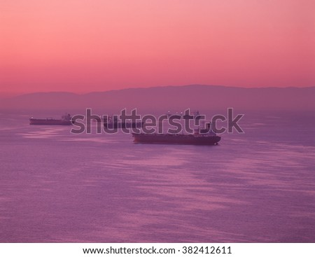 Oil Tankers Moored on San Francisco Bay, Early Morning Sunrise Colors - stock photo
