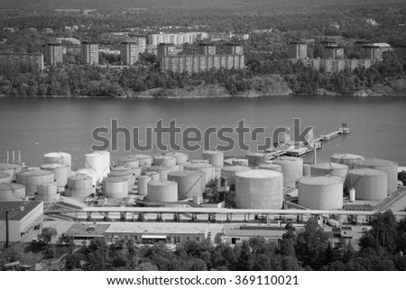 Oil tanks and other silos at Stockholm sea port. Sweden. Black and white retro style. - stock photo