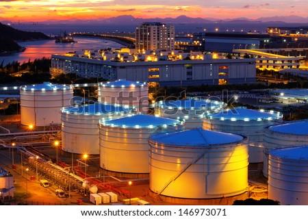 Oil tanks at sunset , hongkong tung chung - stock photo