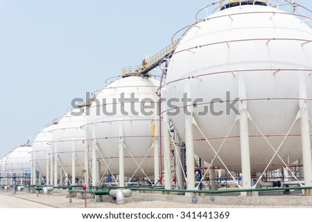 oil tanks in oil depot in clear sky - stock photo