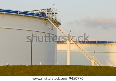 Oil tanks in the warm glow of the evening light