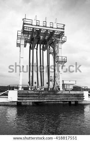 Oil terminal. Equipment for tankers loading on the pier, black and white photo - stock photo