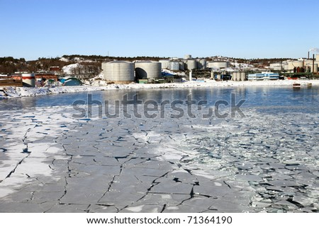 Oil terminal with storage tanks in the harbour Nynashamn, Sweden. - stock photo