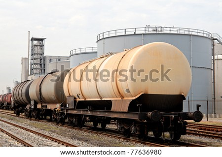 oil train and oil refinery - stock photo