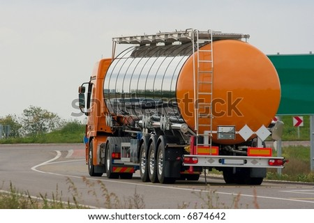 Oil transporting lorry on the road - stock photo