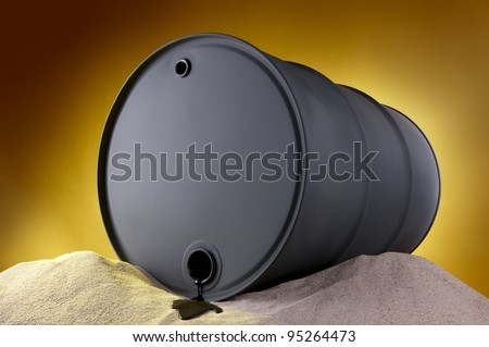 Oil trickles out of barrel onto the desert sand - stock photo