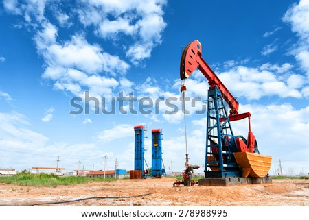 oil well and blue sky - stock photo