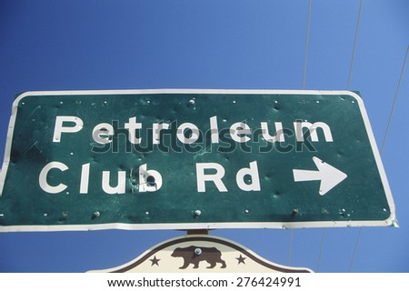 Oil well sign at Taft in the Central Valley, CA - stock photo