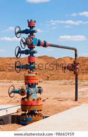 Oil Wellhead in the oil field - stock photo