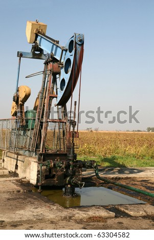 Oil wells is pumping oil and gas at the filed - stock photo
