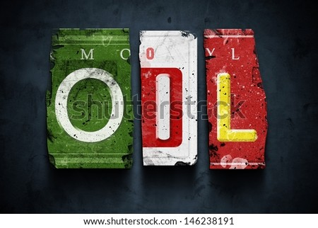 Oil word on vintage broken car license plates, concept sign - stock photo