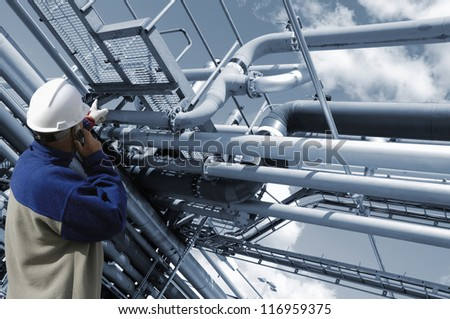 oil worker and pipelines - stock photo
