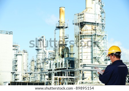 oil worker at oil refinery - stock photo