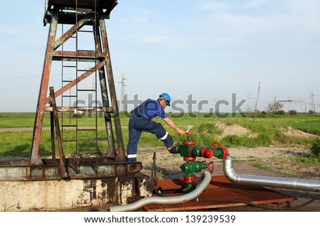 oil worker check pipeline on oilfield - stock photo